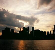 New York City Skyline in Silhouette at Sunset by Vivienne Gucwa