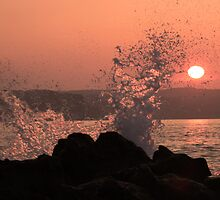Breaking wave in the sunset, Ballycastle, N. Ireland by Ciaran Sidwell