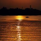Sunset, Country boat heading towards golden rays, river ganges by srijanrc