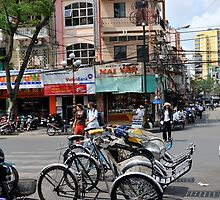 Cyclos (bicycle rickshaws), Ho Chi Minh City, Vietnam by Sheldon Levis