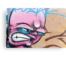 Angry Face Graffiti on a textured Wall Canvas Print