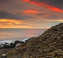 Sunset at Giants Causeway. by Fred Taylor