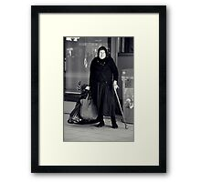 woman with cane Framed Print