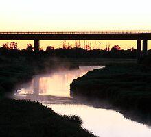 Sunset beyond a bridge. by DominoDude