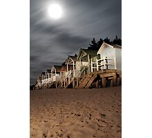 norfolk beach huts by torch light Photographic Print