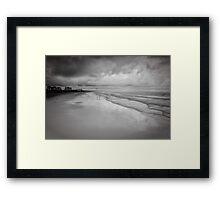 Along the shore Framed Print
