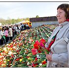 Flowers at the Monument 3, May 9 (Victory Day) 2011, Rga, Latvia.  (2011) by Madeleine Marx-Bentley