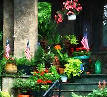 Porch With Geraniums and American Flags by Susan Savad