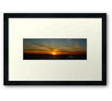 Sailing away from the sunset Framed Print