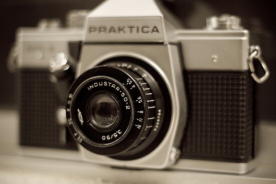 praktica SLR with Russian Industar 50mm lens by harper white