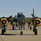 Tight shot of a B-25 Mitchell. by Henry Plumley