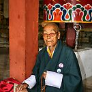 Old Man at Prayer, Thimpu, Bhutan, Eastern Himalaya  by Carole-Anne