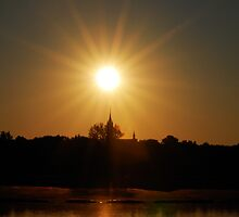 Sun, church and lake by Antanas
