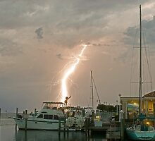A stormy night on the water. by Larry  Grayam