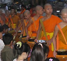 Monks receiving alms by machka