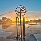 """Sunset Behind Fountain"" by John Hartung"