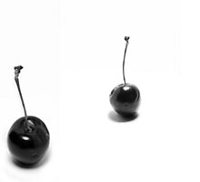 3 black cherries by Michael Mavor