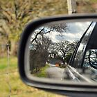 objects in mirror are closer than they appear. by Kassie Yates