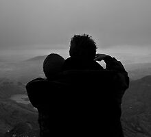 Couple looking out from summit of Mt Snowdon by Jonathan Marsh