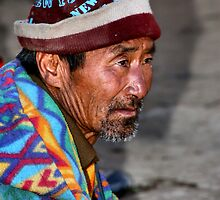 Elderly Man in a Bright jacket. Bhutan, Eastern Himalayas  by Carole-Anne