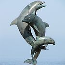Dolphins - a statue at the old malecon by Bernhard Matejka