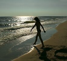 Silhouette of teenage girl on an beach by qiiip