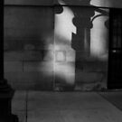 Streetlight shadow on wall by Timothy Wilkendorf