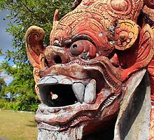 menacing statue at tirta gangga water palace, bali by nicole makarenco