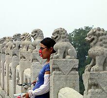 Disguise seller, 17 Arch Bridge, Summer Palace, Beijing by DaveLambert