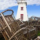 Lighthouse and Old Lobster Traps, North Rustico, PEI by Kenneth Keifer