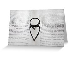 Heart shadow with rings on a book Greeting Card