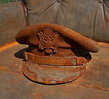 Rusty- old cap on a chair by mypic