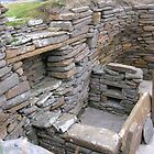 Interior of Neolithic house, Skara Brae by lezvee