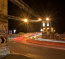Light trails on Menai Suspension Bridge by islandboy
