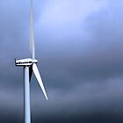 Wind Turbine Against Dark Clouds by Peggy Berger