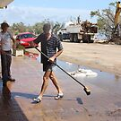 Shop Owners clean up after Cyclone Yasi - Cardwell, North Queensland, Australia by myhobby