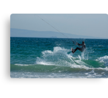 Kite surfer jumping over a wave, Playa de los Lances, Tarifa, Spain. Canvas Print