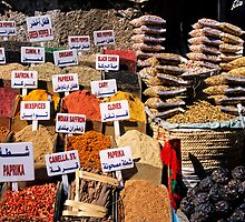Herbs and spices displayed on stall in bazaar by Sami Sarkis