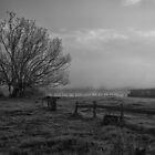 Old farm by a foggy river by Jayde Aleman