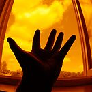 Man with outstretched hand by window by Sami Sarkis