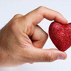 Man holding glittery heart by Sami Sarkis