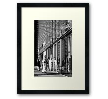 Glass tourists Framed Print
