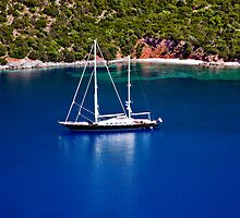 Sailboat anchored at beach in the island of Kefalonia,Greece. by GiannisPar
