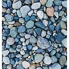Stones on a beach by Tim McGuire
