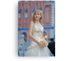 Bride with cream-colour rose bouquet Canvas Print