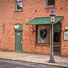 """Town's Necessities"" - restrooms and police station in Berlin, Maryland by John Hartung"