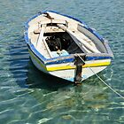 Greek boat in clear water by Gary Heald LRPS