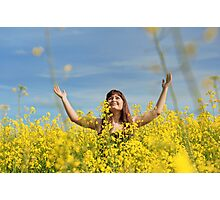 Happy girl in flower meadow. Photographic Print