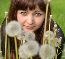 Portrait of beauty girl with dandelions. by fotorobs