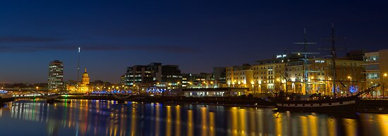 River Liffey with a boat and reflections in the water by David Osuna